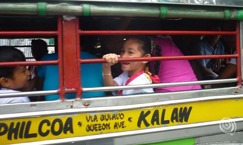 Filipina smiling in a jeepney