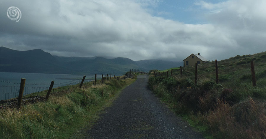 Road in nature with house and mountains in Dingle Peninsula, county of Kerry in Ireland