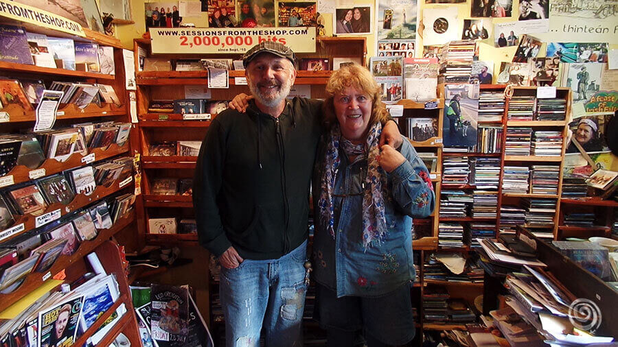 a man and a woman in the smallest record shop in Ireland